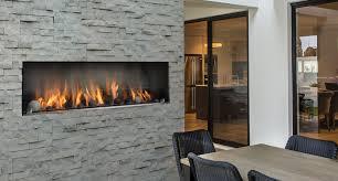 Propane fireplace in brick wall